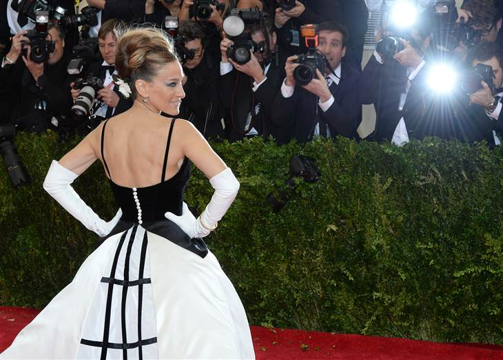 Sarah Jessica Parker in long white opera gloves at the Met Gala
